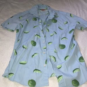Men's light blue collared shirt with limes
